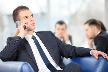 Young business man enjoying a conversation over cellphone
