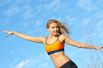 Athletic woman with her arms outstretched