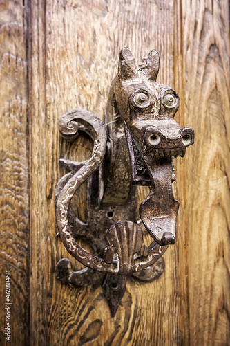 Beautiful dragon shaped door knocker in Pedraza, Segovia, Spain