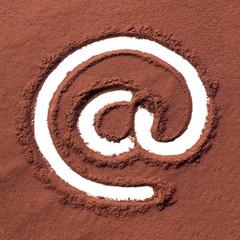 Arroba drawn on cocoa powder