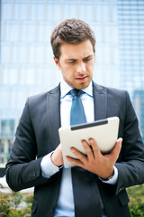 Businessman using a tablet outdoor