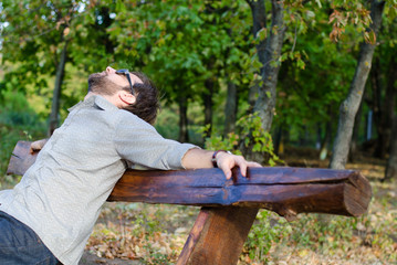 Man relaxing on bench
