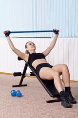 woman training witn dumbbells