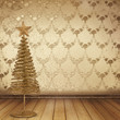 Christmas golden spruce in the old room, decorated with wallpape