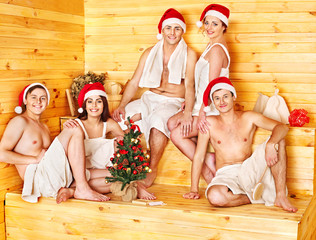 Group people in Santa hat  at sauna.