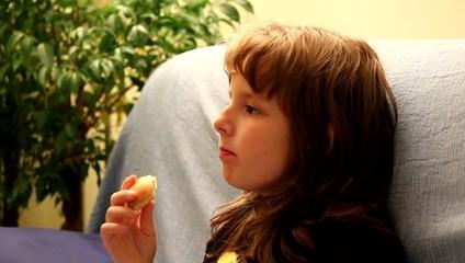 Little girl eating apple slices
