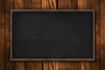 Blank blackboard on wooden wall