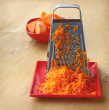 A grater and pieces of pumpkin
