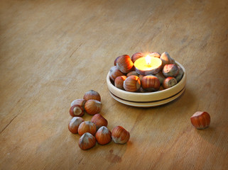 Candle and hazelnuts