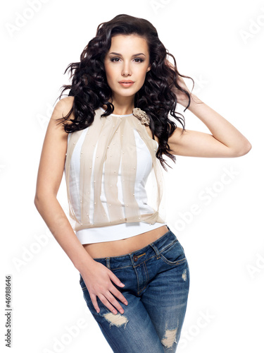 fashion model with long hair dressed in blue jeans