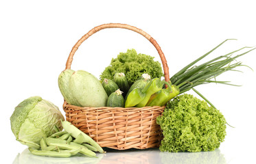 fresh green vegetables in basket isolated on white