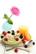 tasty oatmeal with berries and glass of juice,