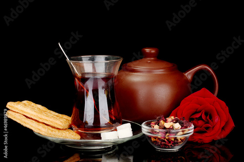 glass of Turkish tea isolated on black
