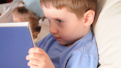Little Boy Reading Education Book in bed