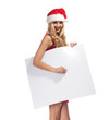 Christmas woman in Santa Clause costume with empty blank board