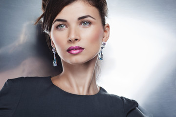 Portrait of  beautiful fashion model posing in exclusive jewelry