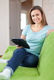girl with e-book on sofa