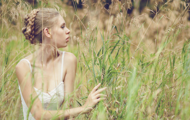 beautiful blond girl in the field