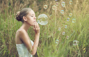 girl starts soap bubbles