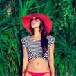 fashion portrait of a woman in a tropical landscape