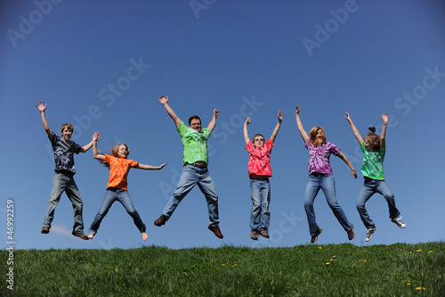 Family of six jumping and having fun