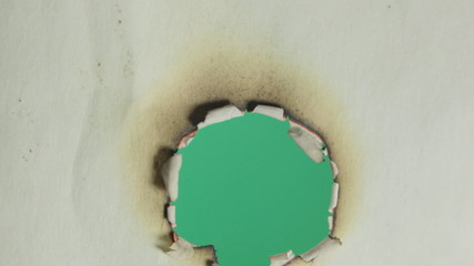Burning paper. Macro. Green screen.