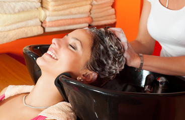 Beautiful young girl enjoying hair washing