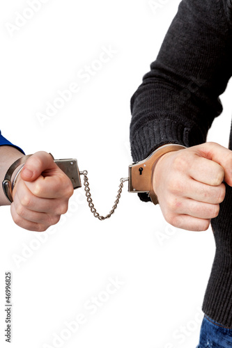 Men and women connected with handcuffs