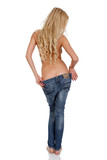 woman taking off jeans, isolated on white
