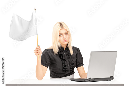 Sad female office worker waving a white flag gesturing defeat