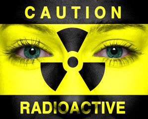 Radioactive sign painted on a woman face