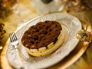 tiramisu over golden table, selective focus
