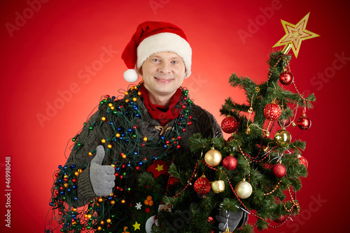 Man with xmas tree