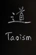 Taoism written on a blackboard