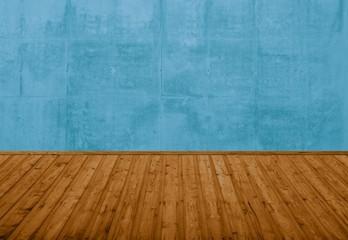 Leerer Raum mit blauer Steinwand und braunem Holzboden