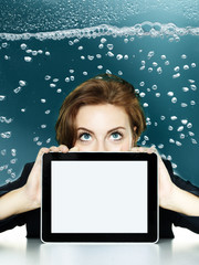 Woman looking over her tablet pc in the water