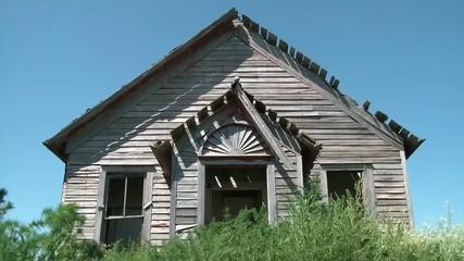 Abandoned Farm House with Blue Sky Background