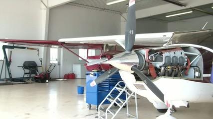 Airplane Hanger Mechanics at Work