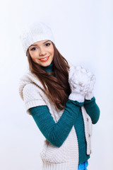 Young woman wearing winter hat and warm scarf