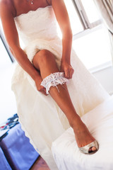 The bride getting dressed