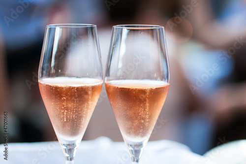 Two glasses filled with champagne - 47001663