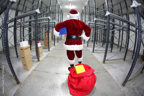 Late Santa Claus in empty storehouse