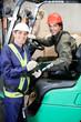 Portrait Of Forklift Driver And Supervisor