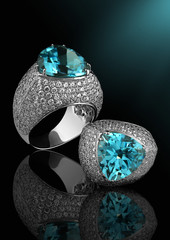 Silver ring with diamonds and topaz
