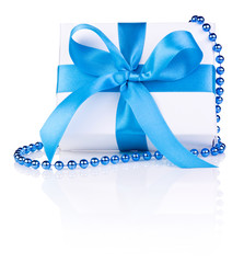 Christmas gift with ribbon bow and beads isolated on white backg