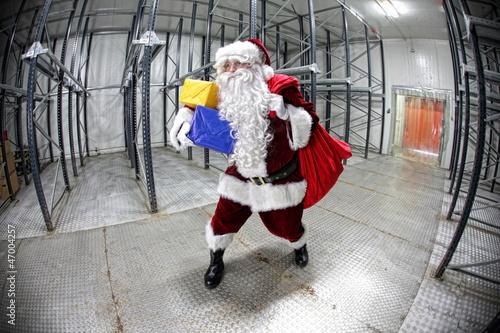 Last minute Santa Claus leaving empty storehouse