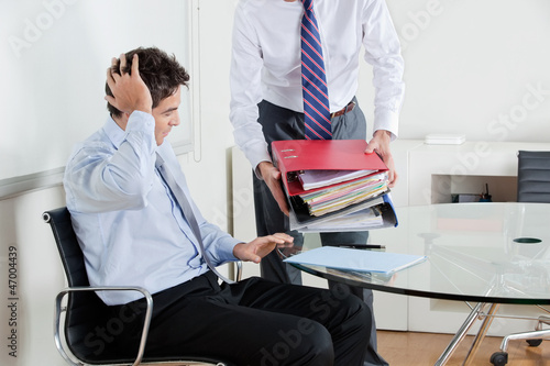 Businessmen Overwhelmed By Load Of Work