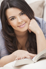 Happy Hispanic Woman Reading Paperback Book