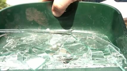 Broken Glass in Dustpan Emptied in Sun