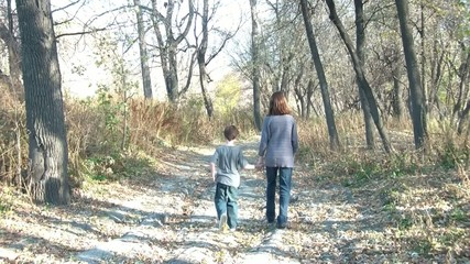 Brother and Sister Holding Hands Walking Away